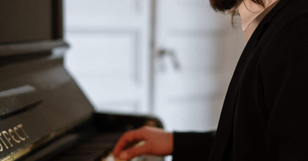 A person standing in front of a piano