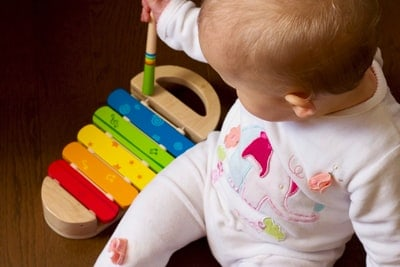 A hand holding a babyXylophone As One Of The Best Music Toys For Baby