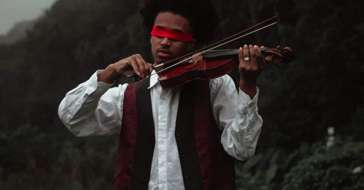 A person holding a violin